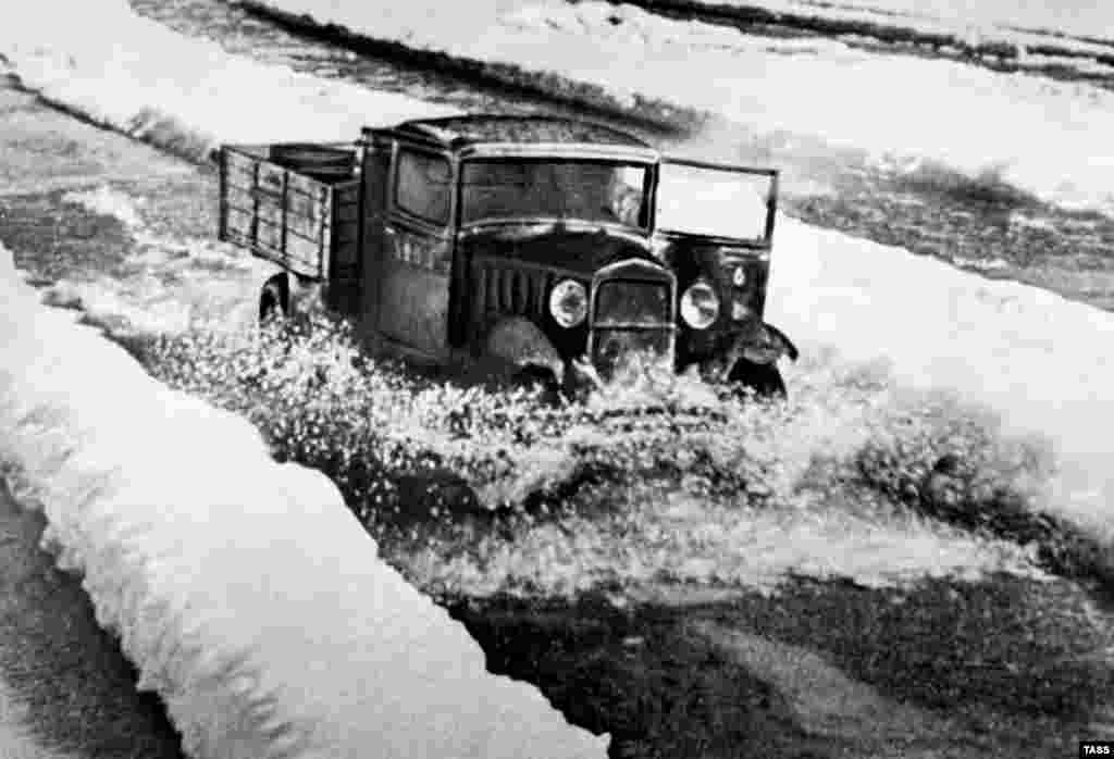 "A truck travels over frozen Lake Ladoga on a route known as ""the Road of Life."" During the winter months of the siege, the frozen lake allowed food, ammunition, and fuel to move into the city, and allowed children, the elderly, and the wounded to be evacuated."