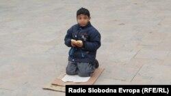 Macedonia - Beggar sitting in a street, Skopje, 30 January 2014.