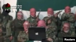 Alleged army defectors say they will try to protect civilians and attack Syrian security forces in this still image taken from amateur video footage shot near Damascus on November 16.
