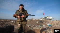 A pro-Russian separatist near the Ukrainian village of Frunze in Luhansk Oblast