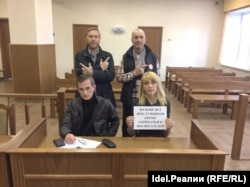 Russian schoolteacher Yelena Blinova (bottom right) landed in hot water when she signaled support for an opposition blogger. (file photo)
