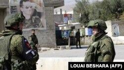 ШыҒыс Ғутамен шектес Дамаск іргесіндегі тексеру және өткізу бекетінде тұрған ресейлік әскери полиция. Сирия, 1 наурыз 2018 жыл.