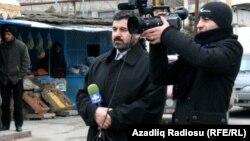 Sahar TV correspondent Anar Bayramli (left) had a year cut from his sentence.