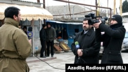 Azerbaijani journalist Anar Bayramli (left) works for the Iranian Sahar TV station,