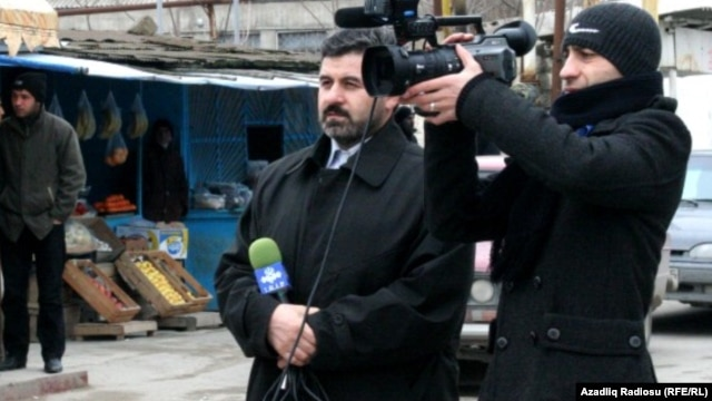 Sahar TV correspondent Anar Bayramli (left) had a year cut from his sentence.