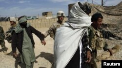 File photo of Afghan detainees in southern Helmand province.