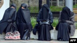 Veiled women take part in a rally of supporters of the Salafist movement in Pforzheim, Germany, in 2014.
