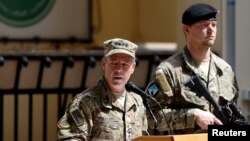 Incoming Commander of Resolute Support forces and command of NATO forces in Afghanistan, U.S. Army General Scott Miller speaks during a change of command ceremony in Resolute Support headquarters in Kabul on September 2.