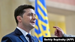 """UKRAINE -- Ukrainian comic actor, showman and presidential candidate Volodymyr Zelenskiy takes part in the shooting of the television series """"Servant of the People"""" where he plays the role of the President of Ukraine, in Kyiv, March 6, 2019"""