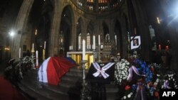 The coffin of former Czech President Vaclav Havel is displayed at St. Vitus Cathedral before the start of his funeral Mass in Prague on December 23.