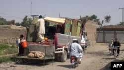 Civilians fleeing the military operations in North Waziristan tribal district, June 13, 2014.