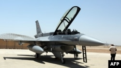 FILE PHOTO - An F-16 fighter jet from the US is seen on the tarmac at Iraq's Balad air base in the Salaheddin province, north of the capital Baghdad, July 20, 2015