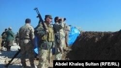 عناصر من قوات حماية الشعب في معبر اليعربية