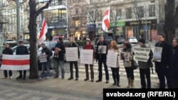 Belarusians protest outside the Skoda offices in downtown Prague.
