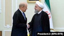 Iranian President Hassan Rohani (right) meets with French Foreign Minister Jean-Yves Le Drian in Tehran on March 5.