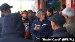 With many unable to leave for Russia to work, groups of men are gathering in the so-called labor market in Dushanbe, waiting for customers to hire them for temporary jobs.