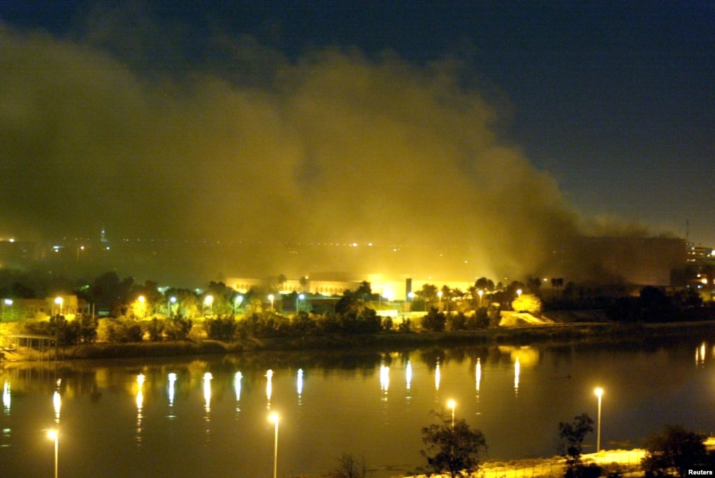 Smoke rises from the Iraqi Planning Ministry on the second day of U.S. raids on the Iraqi capital on March 20, 2003.