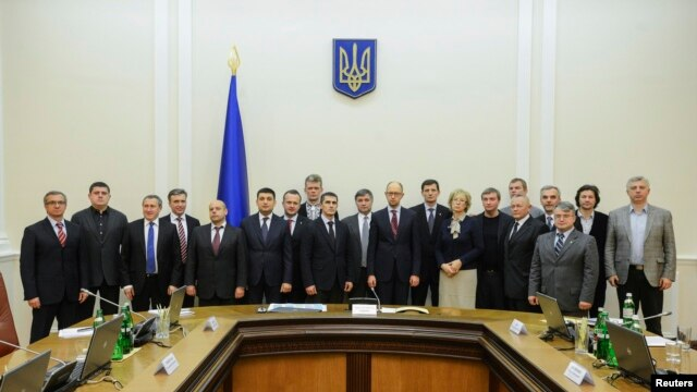 Ukraine -- New prime minister Arseny Yatseniuk (10th R) and his ministers pose for a picture during a meeting in Kyiv, February 27, 2014