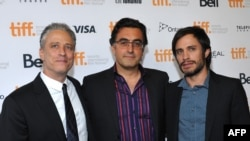 """Rosewater"" film director Jon Stewart, Iranian subject Maziar Bahari, and Mexican actor Gael Garcia Bernal (left to right) pose at the Toronto film festival on September 8."
