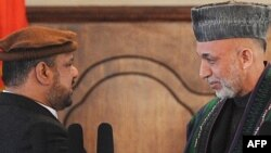 Afghan President Hamid Karzai (right) with Vice President Mohammad Qasim Fahim following the swearing-in ceremony in Kabul