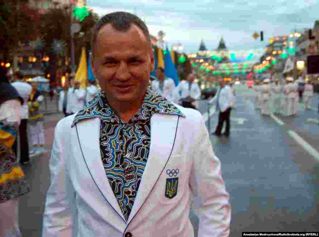 A Ukrainian athlete sports the team's dress uniform with a bold pattern and flared collar during a parade in Kyiv.