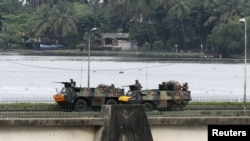 French armored personnel carriers cross General de Gaulle Bridge in Abidjan on April 5.