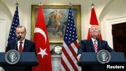 U.S. -- Turkish President Recep Tayyip Erdogan (L) and U.S President Donald Trump deliver statements to reporters in the Roosevelt Room of the White House in Washington, May 16, 2017