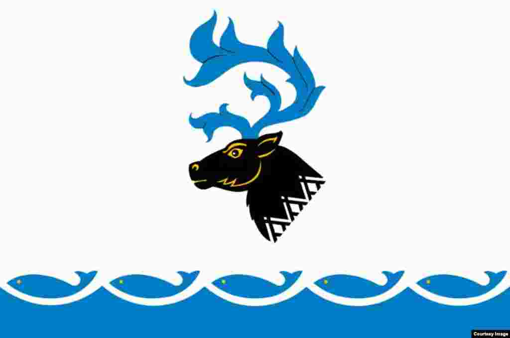 Probably my favorite flag from a purely aesthetic standpoint. It flies over the Yamal district, near the Arctic Ocean. And get this: The antlers of the deer (an important animal for the indigenous population) are flames, a nod to the region's massive gas fields.