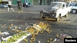 One of the attacks was a suicide bombing at a crowded market in the town of Sweida.