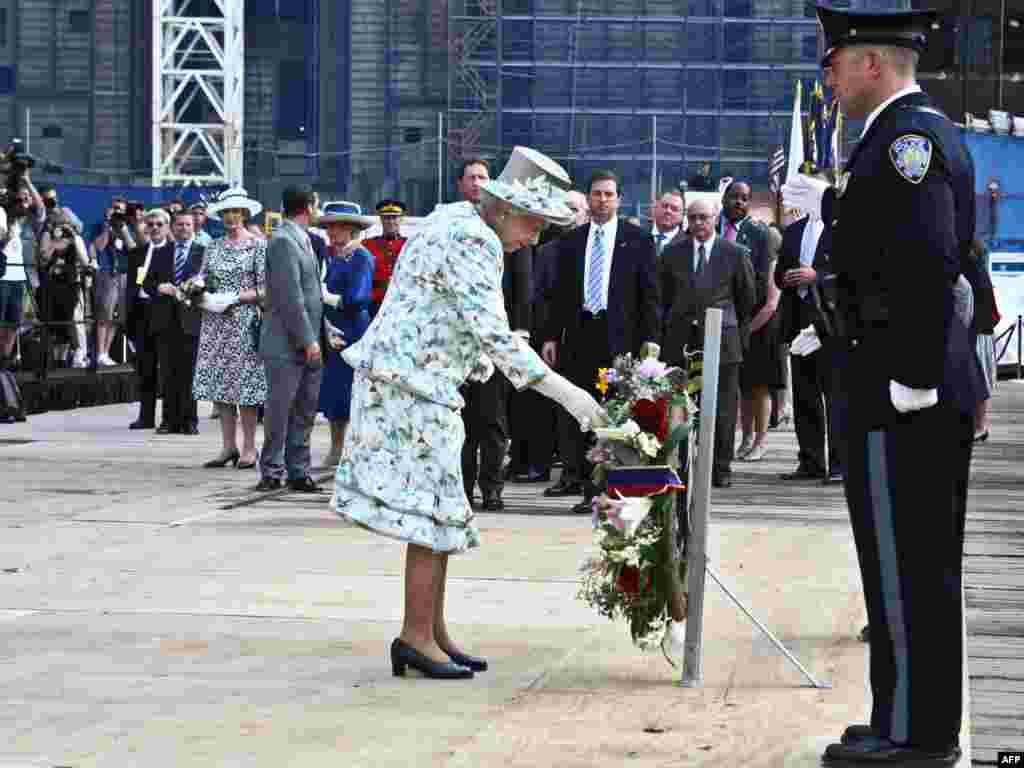 Queen Elizabeth II places a wreath at Ground Zero in New York, the scene of two of the Al-Qaeda attacks that killed thousands of Americans and other nationals on September 11, 2001.