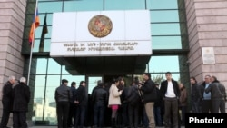 Armenia - People wait outside a district court building in Yerevan, 9Jan2012.