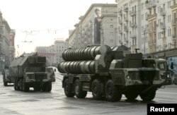 Russian S-300 surface-to-air missile systems move along a central street during a rehearsal for a military parade in Moscow in 2009.