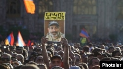 A rally participant holds up an image of protest leader Nikol Pashinian on May 2.