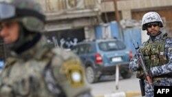 عناصر أمن في نقطة تفتيش عراقية