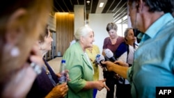 Bosnian women from the Mothers Of Srebrenica group talk to the press in The Hague after the verdict on June 27.