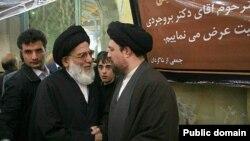 The former head of Iran's judiciary Mahmud Hashemi Shahrudi (left) in conversation with Hassan Khomeini, the grandson of Iran's first supreme leader, Ayatollah Ruhollah Khomeini.