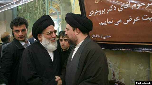 The former head of Iran's judiciary Mahmud Hashemi Shahrudi (left) in conversation with Hassan Khomeini, the grandson of Iran's first supreme leader, Ayatollah Ruhollah Khomeini.