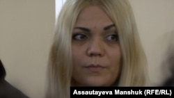 Natalya Slekishina, who gave birth to a girl while in custody, filed a lawsuit against several guards of an Almaty detention center, accusing them of gang-raping her.