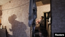 A family of Tajik migrant workers are seen in their house outside Moscow. (file photo)
