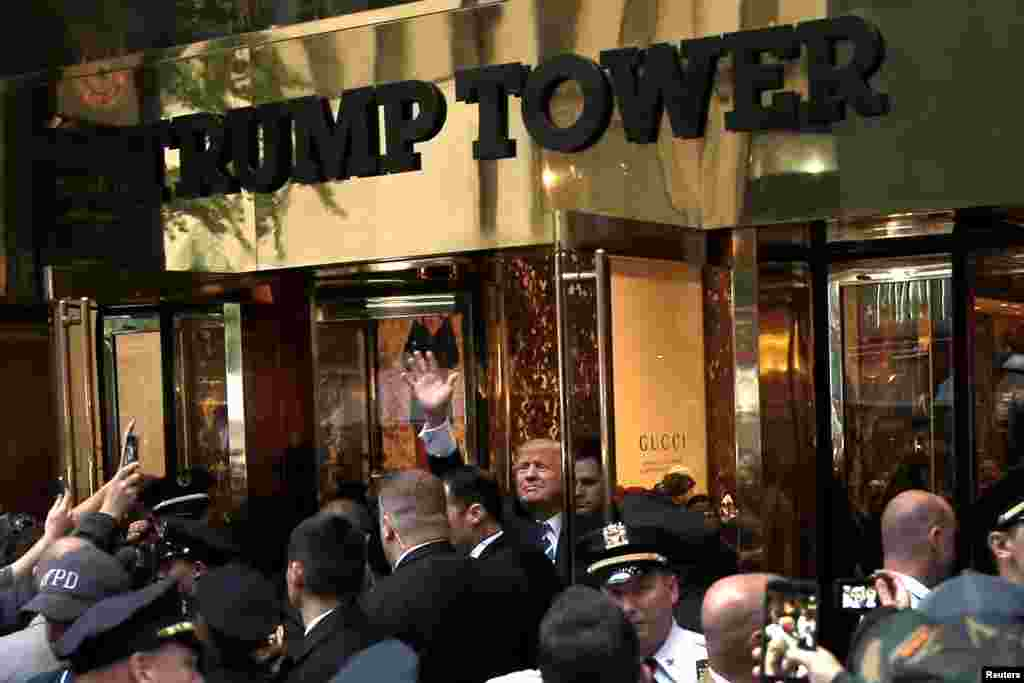 Trump waves to supporters outside Trump Tower in Manhattan on October 8, 2016, one month before his election victory.