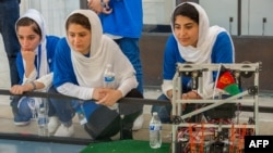 The Afghan girls have designed a robot that can recognize blue and orange and sort balls into correct locations. (file photo)