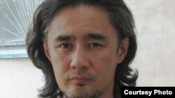 Осужденный оппозиционный активист Айдос Садыков.