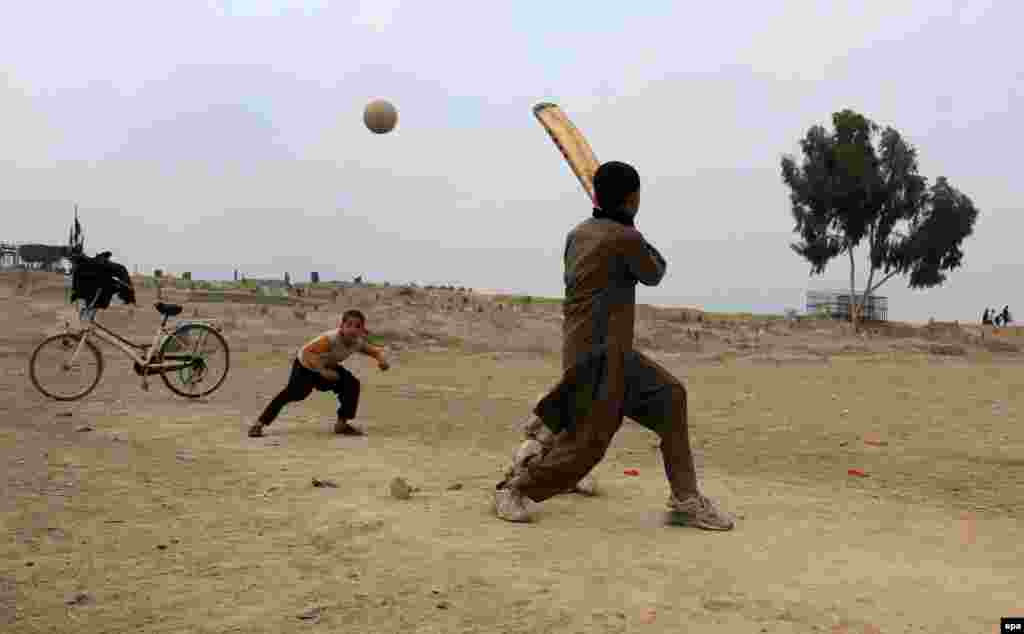 Afghan boys play cricket in Jalalabad.