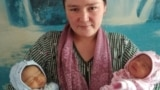 Farida Ghozieva with her newborn twin girls. She believes she also gave birth to a third child.