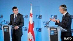 Georgian Prime Minister Giorgi Gakharia and NATO Secretary-General Jens Stoltenberg give a joint press conference in Brussels on September 29.
