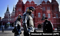 Russian riot police patrol to prevent possible protests in support of Navalny in central Moscow in February.