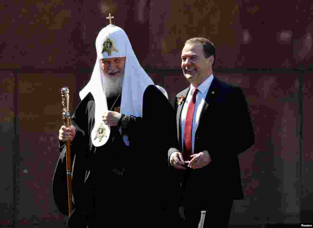 The deputy Head of the Russian Security Council, former President Dmitry Medvedev, and Patriarch Kirill of Moscow and All Russia attend the Victory Day parade.