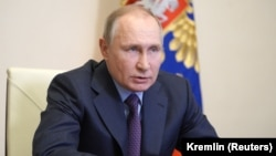 Russian President Vladimir Putin speaking on March 22