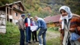 Bosnia-Herzegovina, which is still governed under a structure set out by the Dayton accords, managed to conduct a census in 2013. Here, Bosnian Muslims speak with an enumerator in the village of Krusev Do, near Srebrenica. (file photo)