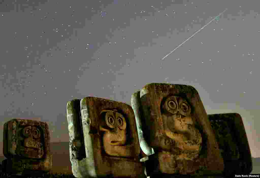A meteor streaks past stars in the night sky above the Necropolis on Smrike for the victims of fascism during the Perseid meteor shower in Novi Travnik, Bosnia-Herzegovina, on August 12. (Reuters/Dado Ruvic)